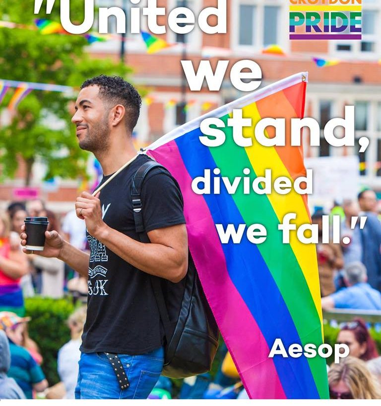 United we stand, divided we fall - gay black man and rainbow flag